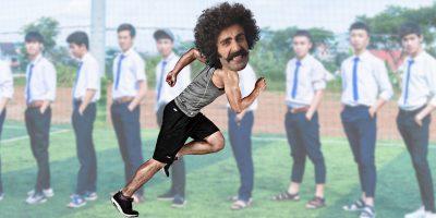 Man running past school children