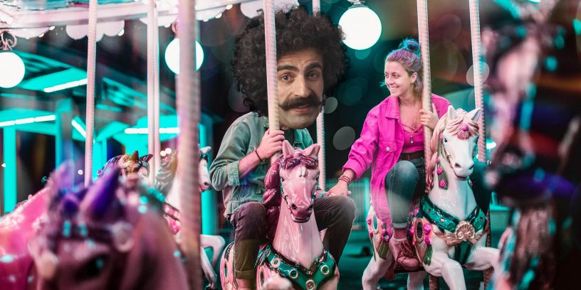 Man on merry-go-round with love interest